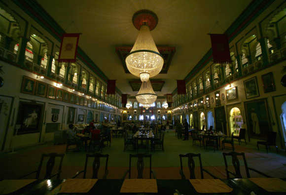 Guests have their food in the dinning hall of the City Palace in Udaipur in Rajasthan.
