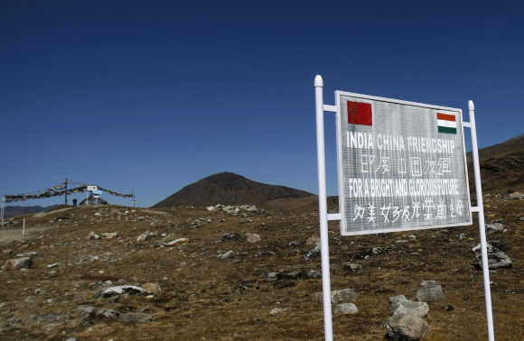 A signboard is seen from the Indian side of the Indo-China border at Bumla in Arunachal Pradesh.