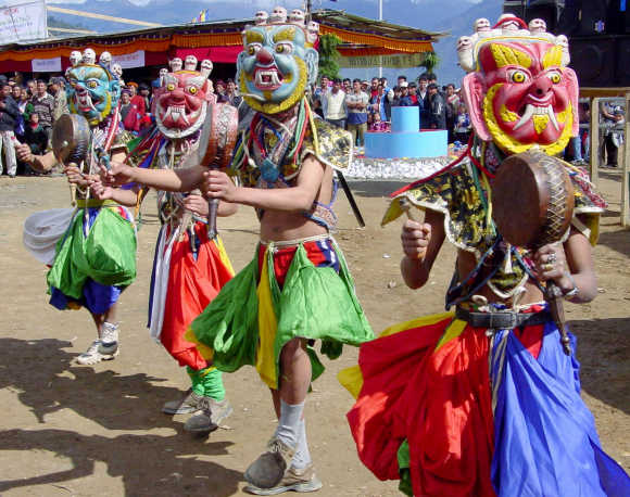 People perform a Monastic dance, a dance performed mainly by monks at a monastery, at the inauguration of a three-day Buddha festival in Tawang district in Arunachal Pradesh.