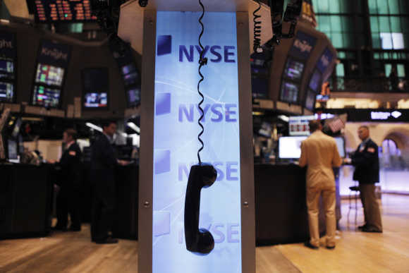 A phone hangs above the floor of the New York Stock Exchange shortly after the opening of the market.