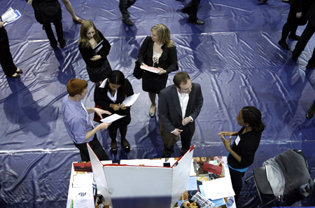 American University students seeking employment speak with job recruiters during a career job fair at American University in Washington.