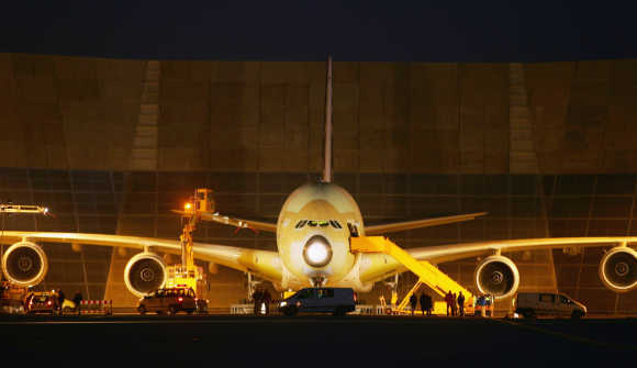 Airbus A380, the world's largest commercial airliner, arrives from Toulouse, France, to Hamburg, Germany.