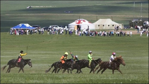 hildren ride horses during a horse racing competition at the annual Naadam Festival in Ulan Bator.
