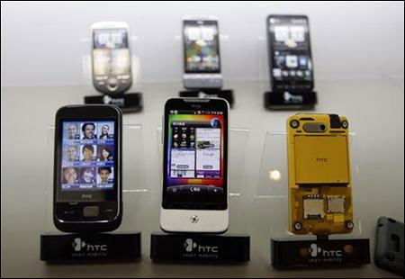 Smartphones are displayed in a mobile phone store in Taipei.