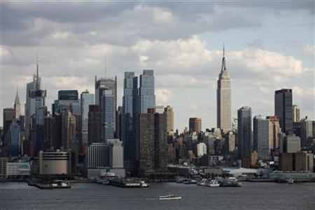 The Empire State Building (R) stands tall on the skyline of midtown Manhattan in New York.