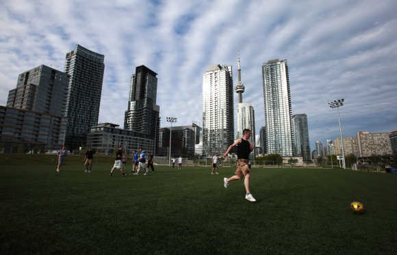 People play a game of pickup soccer in downtown Toronto.