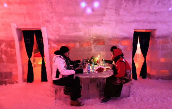 Tourists have dinner inside the Balea Lac Hotel of Ice in the Fagaras mountains, 300km northwest of Bucharest.