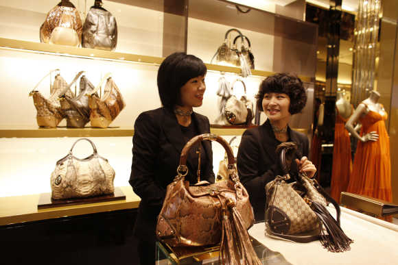 Staff members of the Gucci flagship store in Shanghai chat.