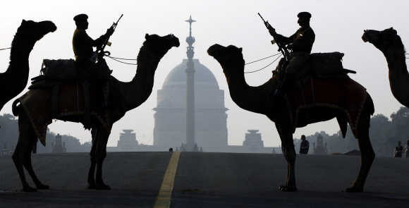Border Security Force soldiers ride their camels in New Delhi.