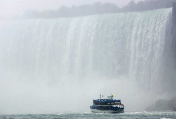 The 'Maid of the Mist' ventures at the bottom of the Horseshoe Falls, Canadian side, at Niagara Falls, Ontario.