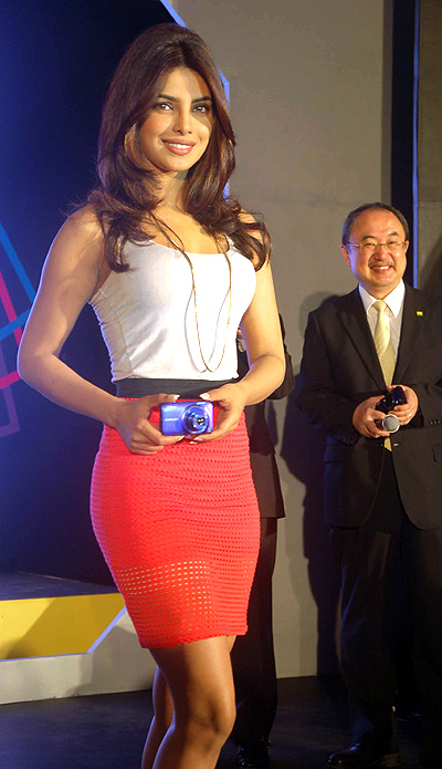 Priyanka Chopra with Hiroshi Takashina (right), MD, Nikon-India, at the launch
