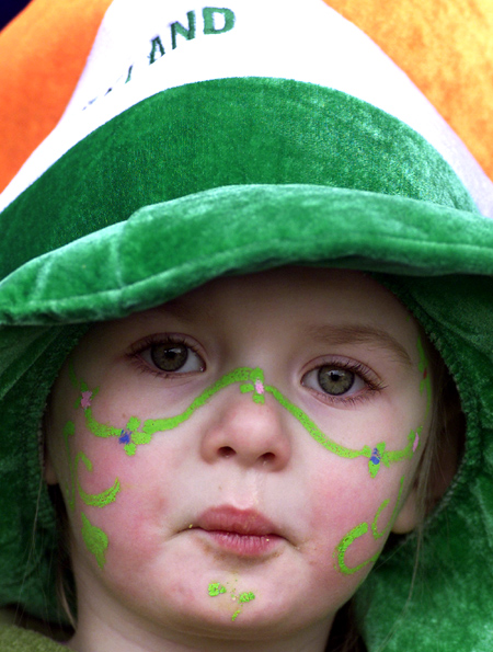 A young parade-goer celebrating St Patrick's Day in Dublin.