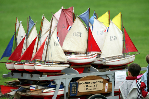 A boy looks at model boats for hire at the pond of Jardin du Luxembourg in Paris.