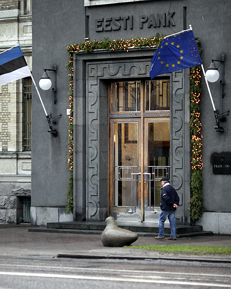 A man walks past Estonia's central bank building in Tallinn.