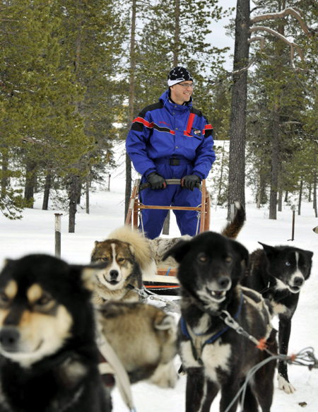 Finnish Prime Minister Jyrki Katainen gets ready for a Husky ride during the informal Lapland meeting on economic affairs in Saariselka, Finland.