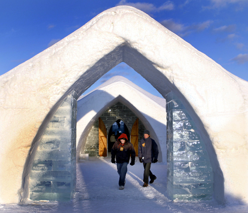 Visitors walk out of Ice Hotel in Sainte-Catherine-de-la-Jacques-Cartier, Quebec.