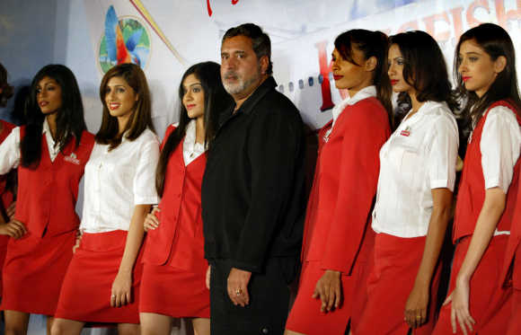 Mallya's business interests are too diverse to allow him the time.