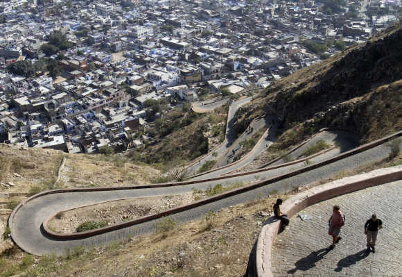 Tourists walk on a pathway that leads to Nahargarh fort in Jaipur.