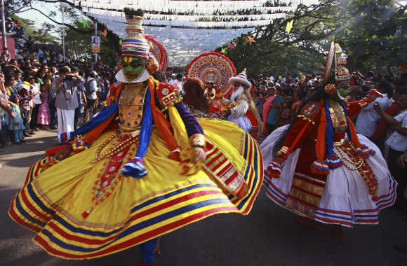 Folk dancers perform during the Cochin Carnival at Fort Kochi in Kochi.