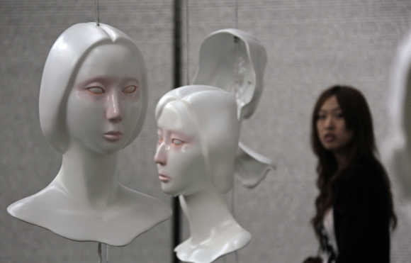 A visitor looks at an art display in Beijing.
