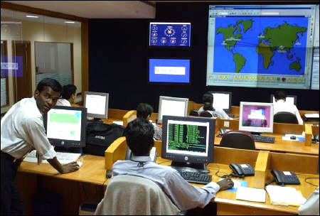 Engineers work in the control room at Infosys Technologies campus at Electronics City in Bangalore.