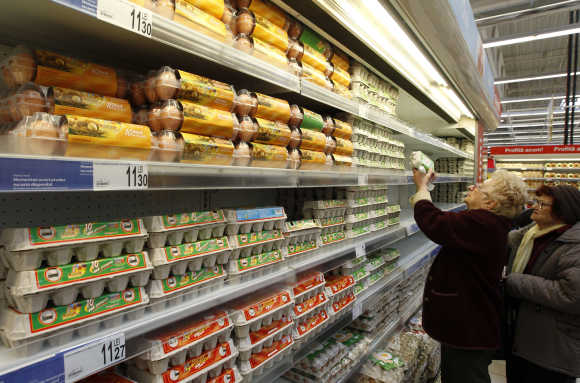 Women buy eggs in a supermarket in Bucharest.