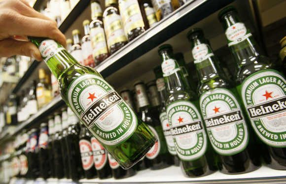 Bottles of Heineken beer are displayed for sale in central London.