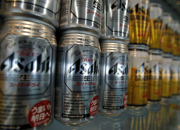 Cans of Asahi Breweries' 'Super Dry' beer are displayed at the company headquarters in Tokyo.