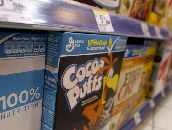 General Mills cereals are displayed on a market's shelf in New York.