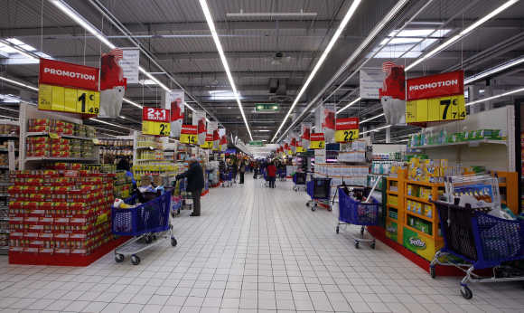 View of an aisle with shopping carts at Carrefour Planet supermarket in Nice Lingostiere, France.