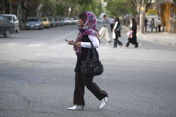 A woman walks in Sanandaj.