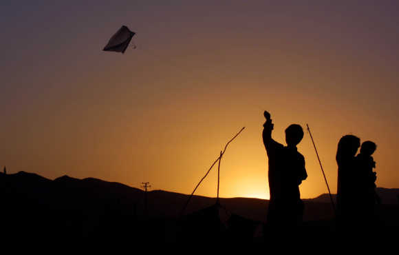 A boy flies a kite in Quetta, Pakistan.