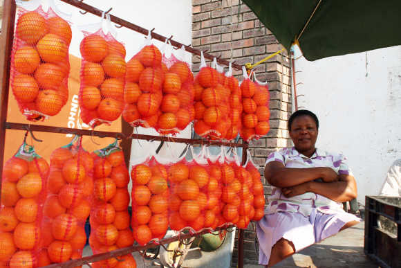 A fruit seller sits near Gaborone, Botswana.