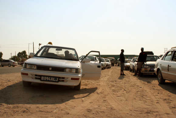 Taxi drivers wait for customers near Gaborone, Botswana.