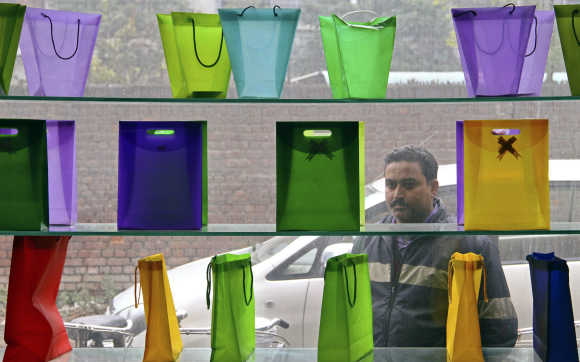 A man looks at poly-bags on display outside a factory at Ludhiana.