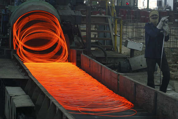 Labourer works inside a steel factory in Kanpur.