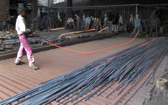 Employees work inside an iron factory in Kanpur.