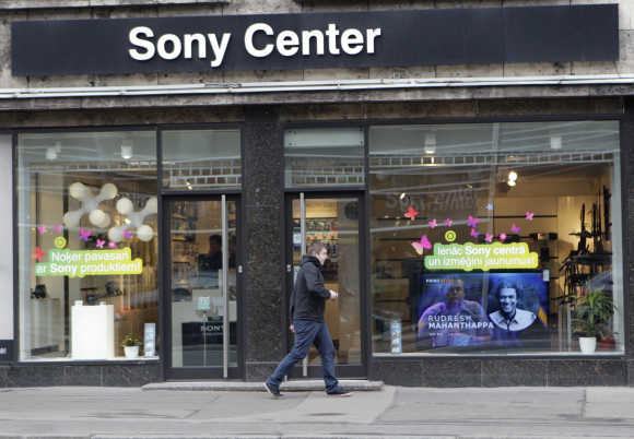 A man walks past Sony shop in Riga, Latvia.