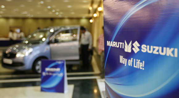 A customer stands inside a Maruti Suzuki's car showroom in Ahmedabad.
