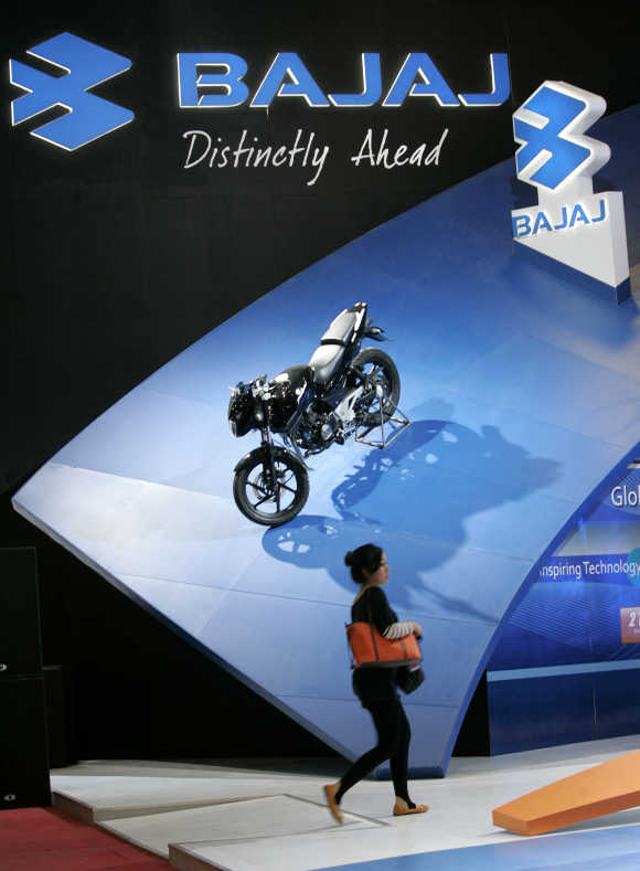 A visitor walks past a Bajaj motorcycle during the Jakarta Motor Show.