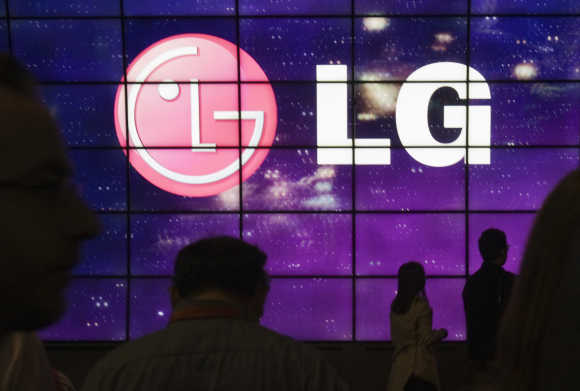 Showgoers walk past a display at the LG Electronics booth during the 2012 International Consumer Electronics Show in Las Vegas.