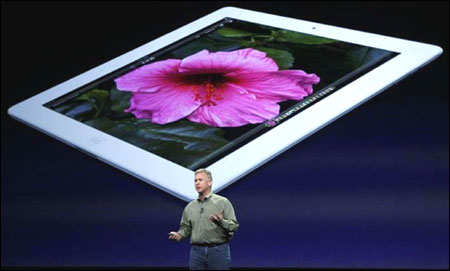 Apple marketing chief Phil Schiller speaks during an Apple event in San Francisco, California on March 7, 2012.
