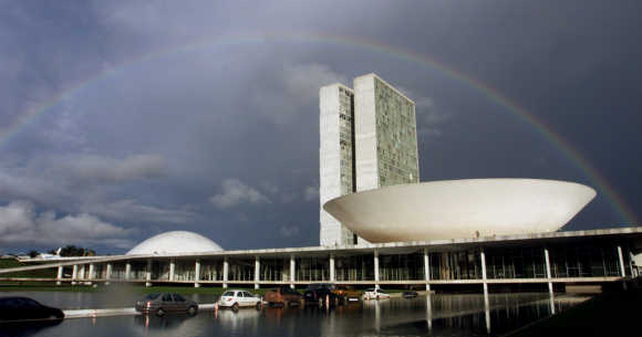 A rainbow forms after a cloudburst over Brazilian Congress in Brasilia.