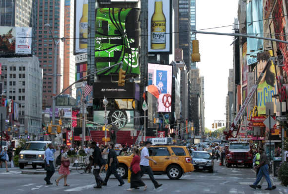 Morning commuters make their way through Times Square in New York.