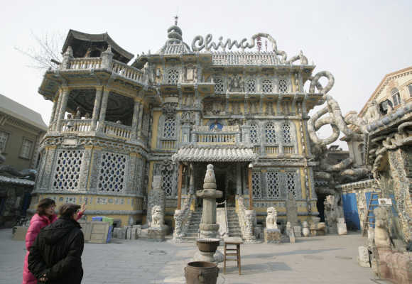 Visitors look at the 'China House' in Tianjin. The house is decorated with hundreds of millions of ancient porcelain flakes, ancient bowls, dishes and vases, inlaid everywhere in the architecture.