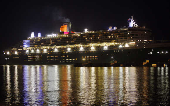The world's largest ocean liner Queen Mary 2 arrives at a jetty in Port Klang, outside Kuala Lumpur.