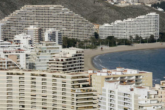 Buildings line up at the beach of Cullera near Valencia.