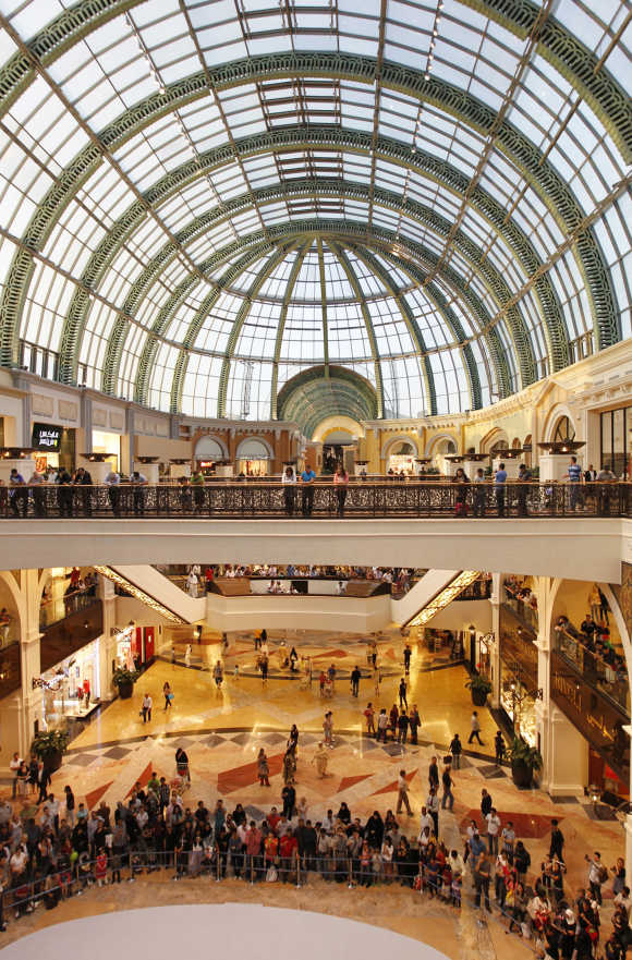 People stand near the fashion dome in Mall of the Emirates, Dubai.