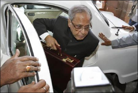 Finance Minister Pranab Mukherjee arrives at the parliament to present the Budget.