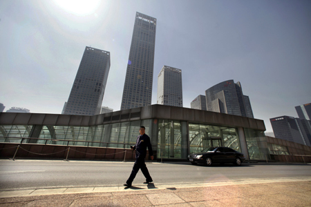 A security guard walks in front of Yintai Centre in Beijing's central business district.